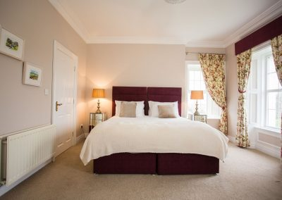Deluxe bedroom with superking bed and seaviews at the Glen House Bed and Breakfast
